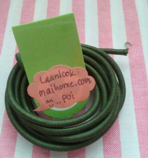ยางยืดแบบกลมสีเขียวขี้ม้าขนาด 0.3 cm ราคาขายต่อ 1 หลา